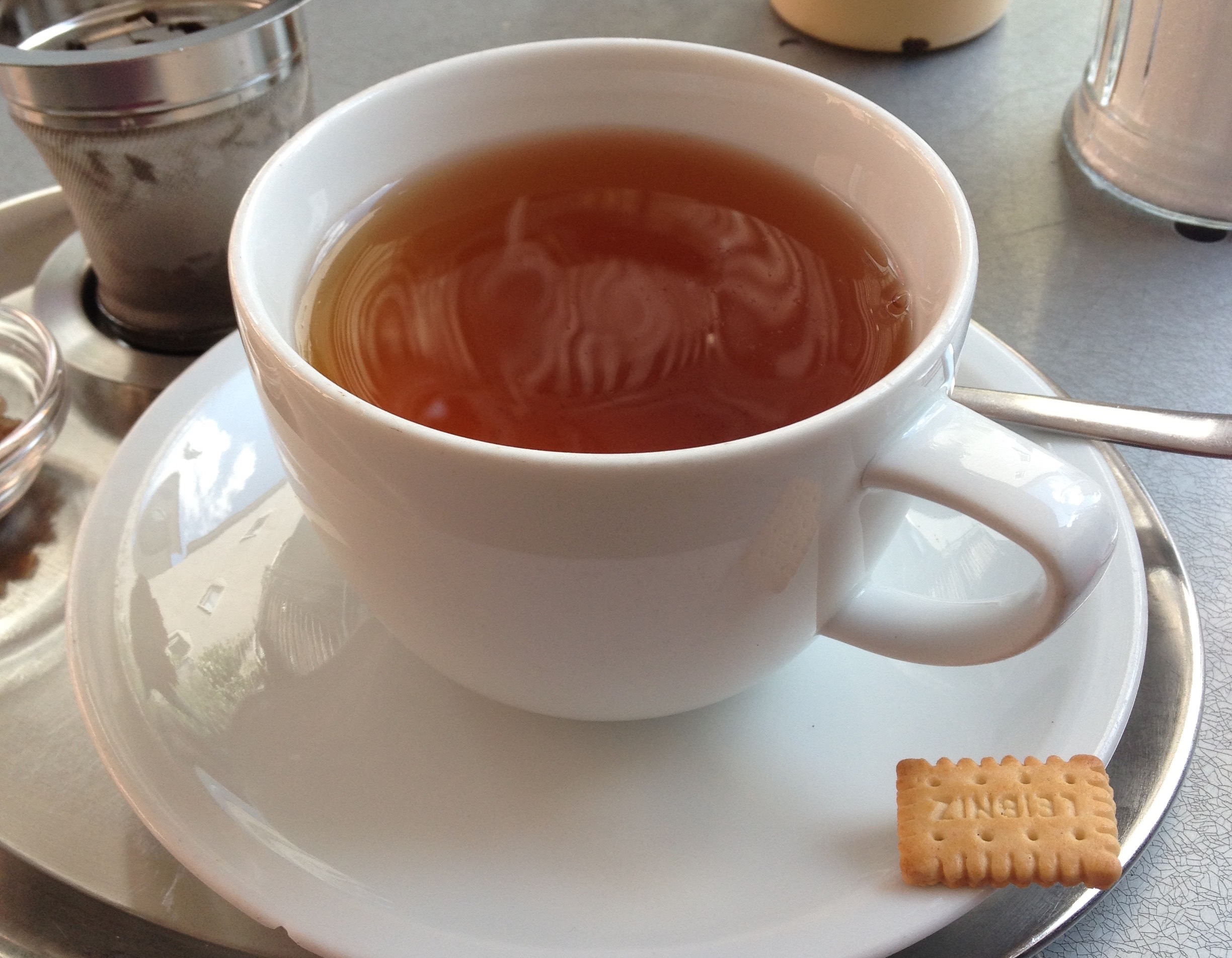 Speed-cutting preparation: a cup of Earl Grey tea and a biscuit