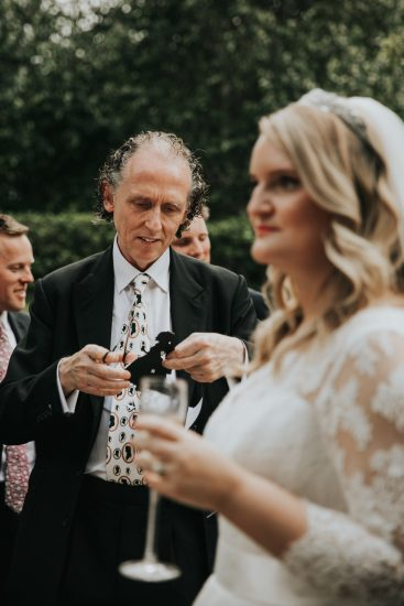 Charles cutting the bride