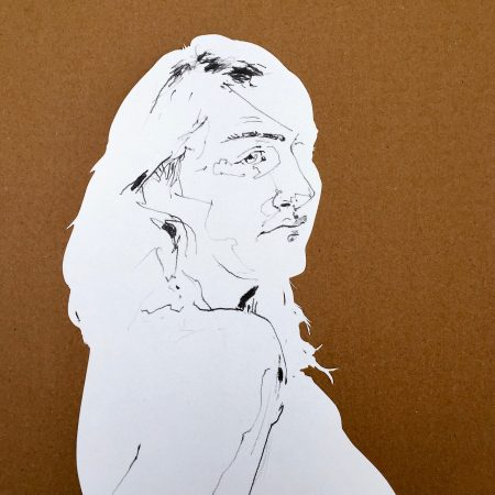 Portrait drawing on cut paper.