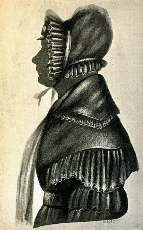 Silhouette of a woman with a bonnet and scarf, painted in some detail