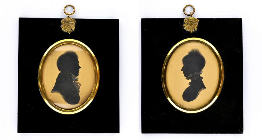 A regency couple face to face in two oval frames