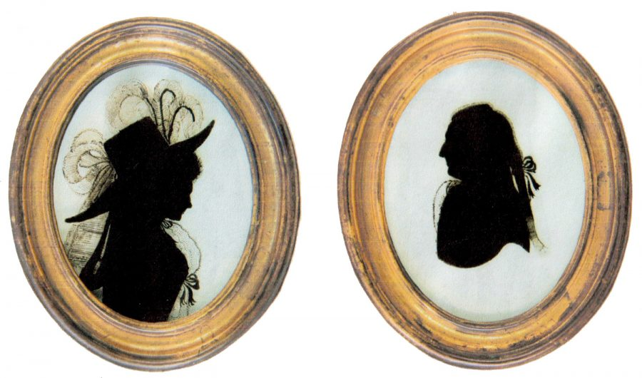 Two elaborate Georgian silhouettes, face to face in oval frames