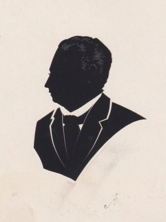 Silhouette of a man with a wide tie, cut in two parts and initialled 'AF'