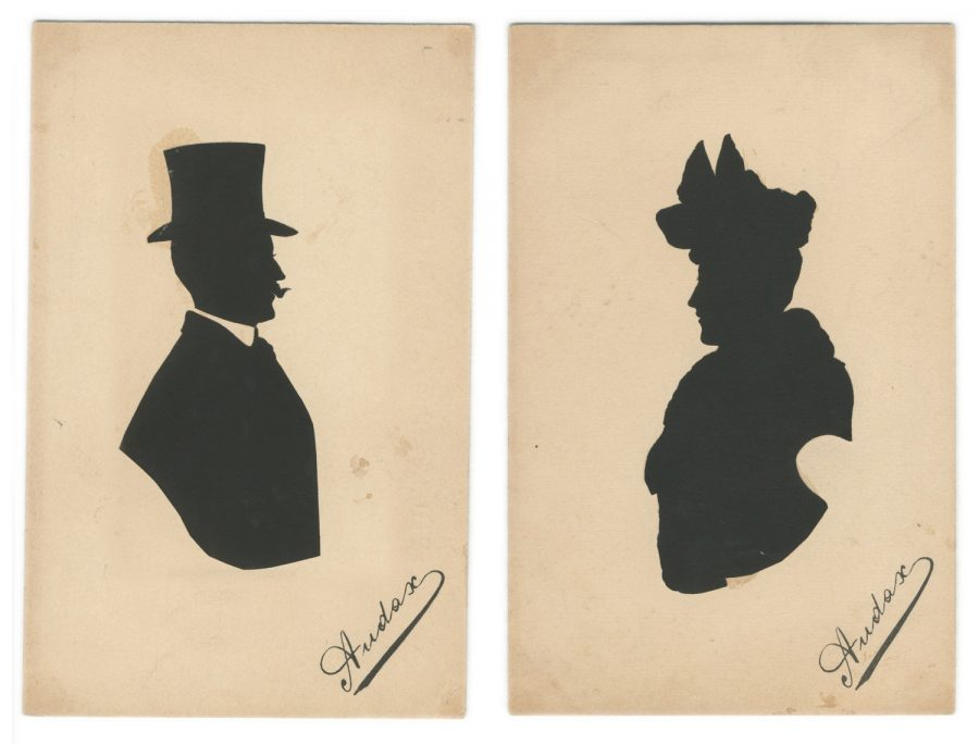 Silhouettes of an Edwardian couple with large hats and signed 'Audax'